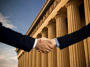 a handshake in front of a federal building
