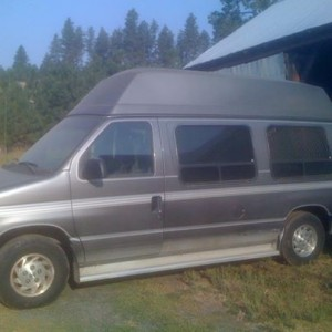 Photo: 1993 Ford Conversion Van with Brand New Tires, Only 61,000 miles, This van has an extra high door for a tall wheel chairs. It also has the Q Straint System. $5,000.  Bobby 310-1749